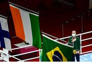 8 August 2021; Kellie Harrington of Ireland stands for the playing of the Irish national anthem after receiving her gold medal after defeating Beatriz Ferreira of Brazil in their women's lightweight final bout with at the Kokugikan Arena during the 2020 Tokyo Summer Olympic Games in Tokyo, Japan. Photo by Brendan Moran/Sportsfile