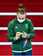 8 August 2021; Kellie Harrington of Ireland looks at her her gold medal during the medal ceremony after defeating Beatriz Ferreira of Brazil in their women's lightweight final bout with at the Kokugikan Arena during the 2020 Tokyo Summer Olympic Games in Tokyo, Japan. Photo by Brendan Moran/Sportsfile