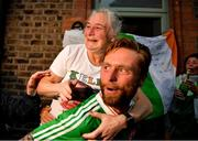 8 August 2021; Kellie Harrington's mother Yvonne and her brother Chirstopher celebrate outside their home at Portland Row in Dublin, after her Tokyo 2020 Olympics lightweight final bout against Beatriz Ferreira of Brazil.  Photo by Ray McManus/Sportsfile