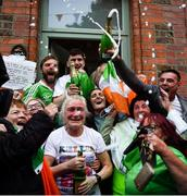 8 August 2021; Champagne flows as Kellie Harrington's mother Yvonne is congratulated outside her Portland Row home, after watching Kellie's Tokyo 2020 Olympics lightweight final bout against Beatriz Ferreira of Brazil. Photo by Ray McManus/Sportsfile