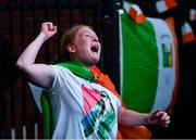 8 August 2021; A neighbour of Kellie Harrington's family, from Portland Row in Dublin, Aeo Gately watching her bout on a big screen when Kellie contested the Tokyo 2020 Olympics lightweight final bout against Beatriz Ferreira of Brazil. Photo by Ray McManus/Sportsfile