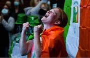8 August 2021; A neighbour of Kellie Harrington's family, from Portland Row in Dublin, Aeo Gately celebrates after watching her bout on a big screen when Kellie contested the Tokyo 2020 Olympics lightweight final bout against Beatriz Ferreira of Brazil. Photo by Ray McManus/Sportsfile