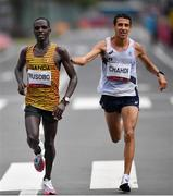 8 August 2021; Fred Musobo of Uganda, left, and Hassan Chahdi of France during the men's marathon at Sapporo Odori Park on day 16 during the 2020 Tokyo Summer Olympic Games in Sapporo, Japan. Photo by Ramsey Cardy/Sportsfile