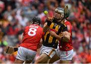 8 August 2021; TJ Reid of Kilkenny is tackled by Darragh Fitzgibbon, left, and Mark Coleman of Cork during the GAA Hurling All-Ireland Senior Championship semi-final match between Kilkenny and Cork at Croke Park in Dublin. Photo by David Fitzgerald/Sportsfile