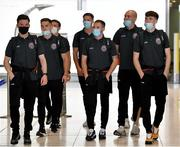10 August 2021; Bohemians players, from left, Ali Coote, Anto Breslin, Keith Buckley, Rob Cornwall, Liam Burt, Georgie Kelly and Stephen Mallon at Dublin Airport prior to their side's departure to Greece for their UEFA Europa Conference League third qualifying round second leg match against PAOK. Photo by Seb Daly/Sportsfile