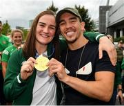 10 August 2021; Gold medallist Kellie Harrington with WBA Interim World Featherweight title holder Michael Conlan at Dublin Airport as Team Ireland's boxers return from the Tokyo 2020 Olympic Games. Photo by Seb Daly/Sportsfile