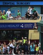 10 August 2021; An emotional Team Ireland women's lightweight gold medallist Kellie Harrington and Emmet Brennan as the bus turns the corner onto Portland Row in Dublin on their return from the Tokyo 2020 Summer Olympic Games. Photo by David Fitzgerald/Sportsfile