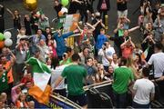 10 August 2021; Supporters cheer on as Team Ireland women's lightweight gold medallist Kellie Harrington and Emmet Brennan pass through Portland Row in Dublin on their return from the Tokyo 2020 Summer Olympic Games. Photo by David Fitzgerald/Sportsfile