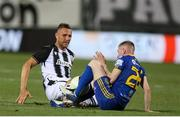 12 August 2021; Ross Tierney of Bohemians tussles for the ball with Jasmin Kurtic of PAOK during the UEFA Europa Conference League Third Qualifying Round Second Leg match between PAOK and Bohemians at Toumba Stadium in Thessaloniki, Greece. Photo by Argiris Makris /Sportsfile