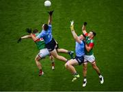 14 August 2021; Brian Fenton, left, and Paddy Small of Dublin in action against Matthew Ruane, left, and Michael Plunkett of Mayo during the GAA Football All-Ireland Senior Championship semi-final match between Dublin and Mayo at Croke Park in Dublin. Photo by Stephen McCarthy/Sportsfile