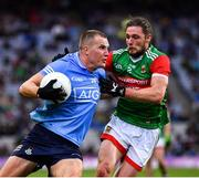 14 August 2021; Ciarán Kilkenny of Dublin is tackled by Pádraig O'Hora of Mayo during the GAA Football All-Ireland Senior Championship semi-final match between Dublin and Mayo at Croke Park in Dublin. Photo by Ray McManus/Sportsfile