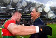 14 August 2021; Mayo coach Ciarán McDonald celebrates with Jordan Flynn after their side's victory in the GAA Football All-Ireland Senior Championship semi-final match between Dublin and Mayo at Croke Park in Dublin. Photo by Piaras Ó Mídheach/Sportsfile