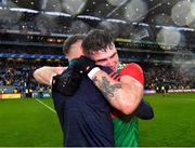 14 August 2021; Jordan Flynn of Mayo, right, celebrates with Mayo coach Ciarán McDonald after their side's victory in the GAA Football All-Ireland Senior Championship semi-final match between Dublin and Mayo at Croke Park in Dublin. Photo by Piaras Ó Mídheach/Sportsfile