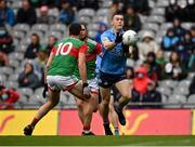 14 August 2021; Con O'Callaghan of Dublin scores a point, under pressure from Diarmuid O'Connor of Mayo, during the GAA Football All-Ireland Senior Championship semi-final match between Dublin and Mayo at Croke Park in Dublin. Photo by Seb Daly/Sportsfile