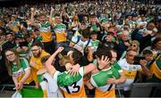 15 August 2021; Cormac Egan, 13, and Fionn Dempsey of Offaly celebrate with supporters following the 2021 Eirgrid GAA Football All-Ireland U20 Championship Final match between Roscommon and Offaly at Croke Park in Dublin. Photo by Stephen McCarthy/Sportsfile