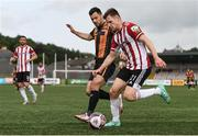 15 August 2021; Cameron McJannet of Derry City in action against Patrick Hoban of Dundalk during the SSE Airtricity League Premier Division match between Derry City and Dundalk at Ryan McBride Brandywell Stadium in Derry. Photo by Ben McShane/Sportsfile