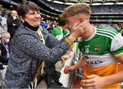 15 August 2021; Jack Bryant of Offaly is congratulated by Anne Moran who is a member of his Shamrocks GAA Club after the 2021 Eirgrid GAA Football All-Ireland U20 Championship Final match between Roscommon and Offaly at Croke Park in Dublin. Photo by Ray McManus/Sportsfile