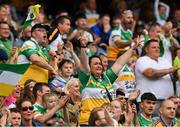 15 August 2021; Offaly supporters, in the Cusack Stand, celebrate a score during the 2021 Eirgrid GAA Football All-Ireland U20 Championship Final match between Roscommon and Offaly at Croke Park in Dublin. Photo by Ray McManus/Sportsfile