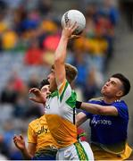 15 August 2021; Jack Bryant of Offaly wins possession ahead of Dylan Gaughan and Roscommon goalkeeper Conor Carroll during the 2021 Eirgrid GAA Football All-Ireland U20 Championship Final match between Roscommon and Offaly at Croke Park in Dublin. Photo by Ray McManus/Sportsfile