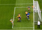 15 August 2021; Jack Bryant of Offaly shoots to score his side's goal past Roscommon defenders and goalkeeper Conor Carroll during the 2021 Eirgrid GAA Football All-Ireland U20 Championship Final match between Roscommon and Offaly at Croke Park in Dublin. Photo by Stephen McCarthy/Sportsfile