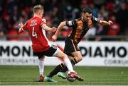 15 August 2021; Michael Duffy of Dundalk and Ciaron Harkin of Derry City during the SSE Airtricity League Premier Division match between Derry City and Dundalk at Ryan McBride Brandywell Stadium in Derry. Photo by Ben McShane/Sportsfile