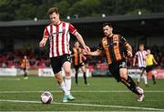 15 August 2021; Cameron McJannet of Derry City and Patrick Hoban of Dundalk during the SSE Airtricity League Premier Division match between Derry City and Dundalk at Ryan McBride Brandywell Stadium in Derry. Photo by Ben McShane/Sportsfile