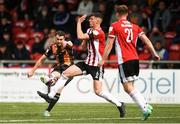 15 August 2021; Michael Duffy of Dundalk has a shot on goal despite the attention of Eoin Toal of Derry City during the SSE Airtricity League Premier Division match between Derry City and Dundalk at Ryan McBride Brandywell Stadium in Derry. Photo by Ben McShane/Sportsfile