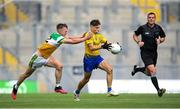 15 August 2021; David Wynne of Roscommon is tackled by Cathal Donoghue of Offaly during the 2021 Eirgrid GAA Football All-Ireland U20 Championship Final match between Roscommon and Offaly at Croke Park in Dublin. Photo by Stephen McCarthy/Sportsfile