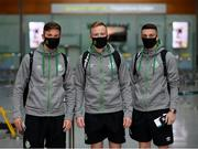 18 August 2021; Shamrock Rovers players, from left, Ronan Finn, Sean Hoare and Gary O'Neill at Dublin Airport prior to their team's departure to Estonia for their UEFA Europa Conference League Play-Off First Leg match against Flora Tallinn. Photo by Stephen McCarthy/Sportsfile