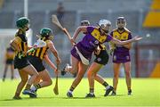 21 August 2021; Jackie Quigley of Wexford in action against Kilkenny players, from left, Michelle Teehan, Miriam Walsh and Claire Phelan during the All-Ireland Senior Camogie Championship quarter-final match between Kilkenny and Wexford at Páirc Uí Chaoimh in Cork. Photo by Piaras Ó Mídheach/Sportsfile