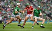 22 August 2021; Robbie O'Flynn of Cork is tackled by Kyle Hayes, left, and William O'Donoghue of Limerick during the GAA Hurling All-Ireland Senior Championship Final match between Cork and Limerick in Croke Park, Dublin. Photo by Ray McManus/Sportsfile