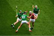 22 August 2021; Tim O'Mahony of Cork in action against Limerick players, left to right, William O'Donoghue, Gearóid Hegarty, and Cian Lynch during the GAA Hurling All-Ireland Senior Championship Final match between Cork and Limerick in Croke Park, Dublin. Photo by Daire Brennan/Sportsfile