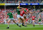 22 August 2021; Dan Morrissey of Limerick catches the sliothar ahead of Robbie O'Flynn, centre, and Darragh Fitzgibbon of Cork during the GAA Hurling All-Ireland Senior Championship Final match between Cork and Limerick in Croke Park, Dublin. Photo by Brendan Moran/Sportsfile