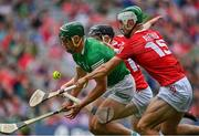 22 August 2021; Seán Finn of Limerick is tackled by Shane Kingston, right, and Jack O'Connor of Cork during the GAA Hurling All-Ireland Senior Championship Final match between Cork and Limerick in Croke Park, Dublin. Photo by Brendan Moran/Sportsfile