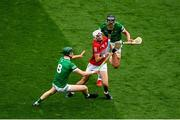 22 August 2021; Tim O'Mahony of Cork in action against William O'Donoghue, left, and Gearóid Hegarty of Limerick during the GAA Hurling All-Ireland Senior Championship Final match between Cork and Limerick in Croke Park, Dublin. Photo by Daire Brennan/Sportsfile