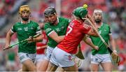 22 August 2021; Eoin Cadogan of Cork is tackled by Gearóid Hegarty of Limerick during the GAA Hurling All-Ireland Senior Championship Final match between Cork and Limerick in Croke Park, Dublin. Photo by Brendan Moran/Sportsfile