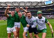 22 August 2021; Limerick players, from left, Seán Finn, Gearóid Hegarty Peter Casey, Mike Casey and Nickie Quaid celebrate after their side's victory in the GAA Hurling All-Ireland Senior Championship Final match between Cork and Limerick in Croke Park, Dublin. Photo by Piaras Ó Mídheach/Sportsfile