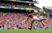22 August 2021; Gearóid Hegarty of Limerick scores his side's third goal despite the attempts of Robert Downey of Cork during the GAA Hurling All-Ireland Senior Championship Final match between Cork and Limerick in Croke Park, Dublin.  Photo by Ramsey Cardy/Sportsfile