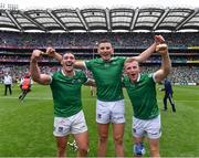 22 August 2021; Limerick players, from left, Seán Finn, Gearóid Hegarty and Peter Casey celebrate after their side's victory in the GAA Hurling All-Ireland Senior Championship Final match between Cork and Limerick in Croke Park, Dublin. Photo by Piaras Ó Mídheach/Sportsfile