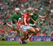 22 August 2021; Robbie O'Flynn of Cork is tackled by Kyle Hayes, left, and Gearóid Hegarty of Limerick during the GAA Hurling All-Ireland Senior Championship Final match between Cork and Limerick in Croke Park, Dublin. Photo by Ray McManus/Sportsfile