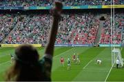 22 August 2021; A Limerick fan cheers as Gearóid Hegarty of Limerick celebrates scoring his side's third goal during the GAA Hurling All-Ireland Senior Championship Final match between Cork and Limerick in Croke Park, Dublin. Photo by Harry Murphy/Sportsfile
