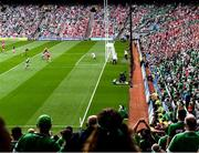 22 August 2021; Supporters look on as Gearóid Hegarty of Limerick shoots to score his side's third goal during the GAA Hurling All-Ireland Senior Championship Final match between Cork and Limerick in Croke Park, Dublin. Photo by Harry Murphy/Sportsfile