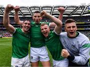 22 August 2021; Limerick players, from left, Seán Finn, Gearóid Hegarty Peter Casey, and Mike Casey celebrate after their side's victory in the GAA Hurling All-Ireland Senior Championship Final match between Cork and Limerick in Croke Park, Dublin. Photo by Piaras Ó Mídheach/Sportsfile