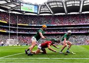 22 August 2021; Eoin Cadogan of Cork in action against Tom Morrissey, left, and Aaron Gillane of Limerick during the GAA Hurling All-Ireland Senior Championship Final match between Cork and Limerick in Croke Park, Dublin. Photo by Piaras Ó Mídheach/Sportsfile