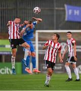 27 August 2021; Ryan Rainey of Finn Harps in action against Ronan Boyce of Derry City during the extra.ie FAI Cup Second Round match between Finn Harps and Derry City at Finn Park in Ballybofey, Donegal. Photo by Ramsey Cardy/Sportsfile