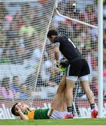 28 August 2021; Tyrone goalkeeper Niall Morgan assists David Clifford of Kerry after picking up a cramp during the GAA Football All-Ireland Senior Championship semi-final match between Kerry and Tyrone at Croke Park in Dublin. Photo by Stephen McCarthy/Sportsfile