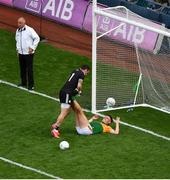 28 August 2021; Niall Morgan of Tyrone helps David Clifford of Kerry stretch his legs during the GAA Football All-Ireland Senior Championship semi-final match between Kerry and Tyrone at Croke Park in Dublin. Photo by Daire Brennan/Sportsfile