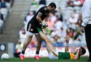 28 August 2021; Tyrone goalkeeper Niall Morgan helps David Clifford of Kerry with an injury during the GAA Football All-Ireland Senior Championship semi-final match between Kerry and Tyrone at Croke Park in Dublin. Photo by Piaras Ó Mídheach/Sportsfile