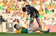 28 August 2021; Paudie Clifford of Kerry is assisted by Tyrone goalkeeper Niall Morgan during the GAA Football All-Ireland Senior Championship semi-final match between Kerry and Tyrone at Croke Park in Dublin. Photo by Brendan Moran/Sportsfile