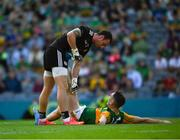 28 August 2021; Tyrone goalkeeper Niall Morgan offers assistance to Paudie Clifford of Kerry during extra time in the GAA Football All-Ireland Senior Championship semi-final match between Kerry and Tyrone at Croke Park in Dublin. Photo by Ray McManus/Sportsfile